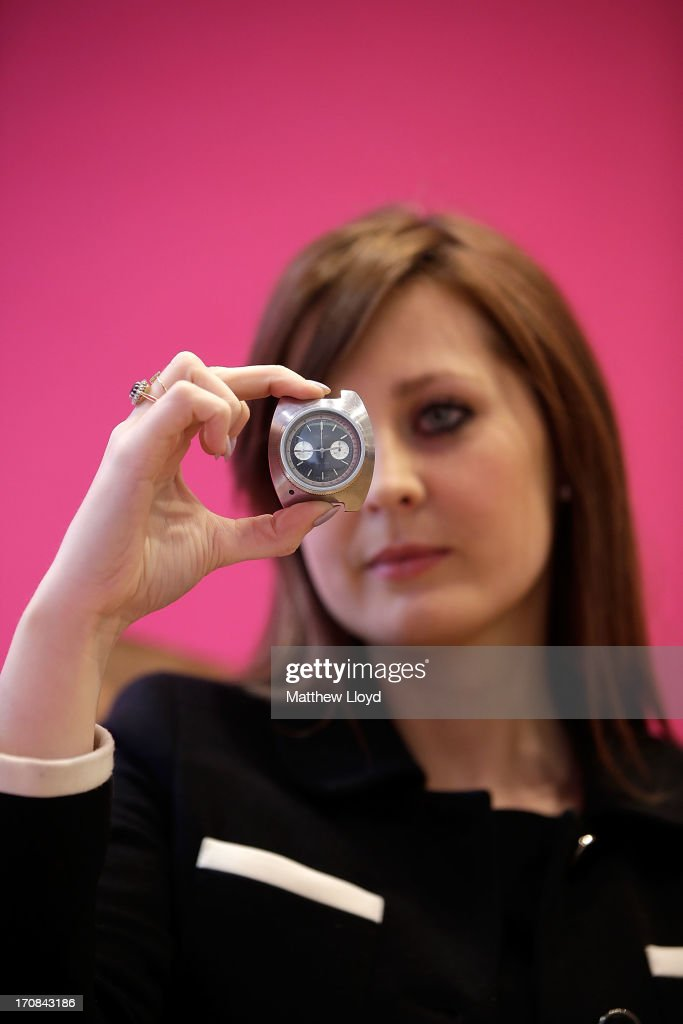 A member of staff holds a Breitling watch, worn by Sean Connery in the James Bond film Thunderball, for sale at Christie's South Kensington on June 19, 2013 in London, England. The item is part of an auction entitled 'Pop Culture' featuring memorabilia charting the history of cinema, pop and rock and roll.