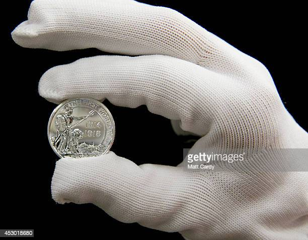 A member of staff holds the new £20 silver coin made to commemorate one hundred years since the outbreak of the First World War at the Royal Mint on...