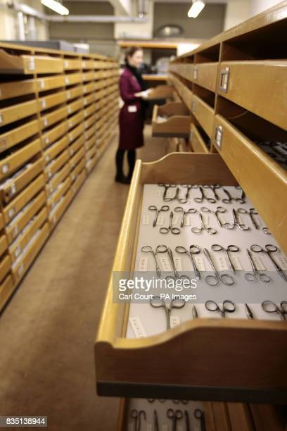 A member of staff inspects an antique surgical tool at the Science Museum object store in London prior to the launch of the Science Museum website...