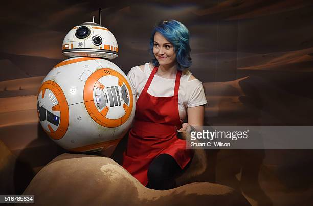 A member of staff makes finishing touches to the Star Wars BB8 figure unveiled at Madame Tussauds London on March 21 2016 in London United Kingdom