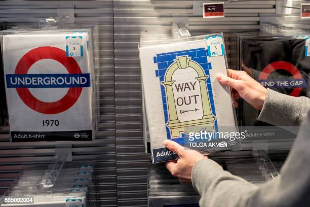 A member of staff places tshirts for display in London Transport Museum in Covent Garden in London on October 22 2017 Britain could be left 'poorer...