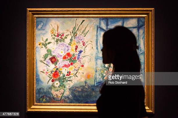 A member of staff poses beside Marc Chagall's 19591960 piece 'Bouquet pres de la fenetre' estimated at between £2535 million at Christie's King...