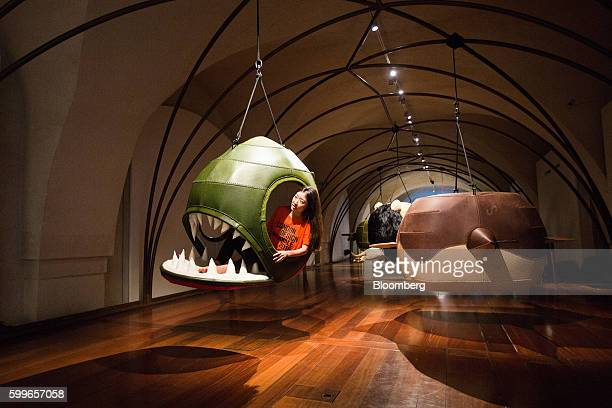 A member of staff poses with the Piranha 1 Nerina designed by Porky Hefer representing South Africa during a preview of the London Design Biennale at...
