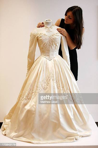 A member of staff prepares a dress worn by Elizabeth Taylor for her first wedding in 1950 for sale at Christie's South Kensington on June 19 2013 in...
