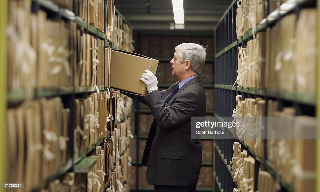 A member of staff removes a file from a depository at The National Archives on August 31, 2006 in London, England. The National Archives have announced the fifteenth release of Security Service records and the fourth since the full implementation of the Freedom of Information Act in January 2005. This release contains 214 files, bringing the total number of Security Service records in the public domain to well over 3,000.