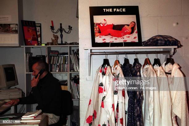 A member of staff talking on the telephone in the Puppy home and clothes store at 26 Portobello Green in west London