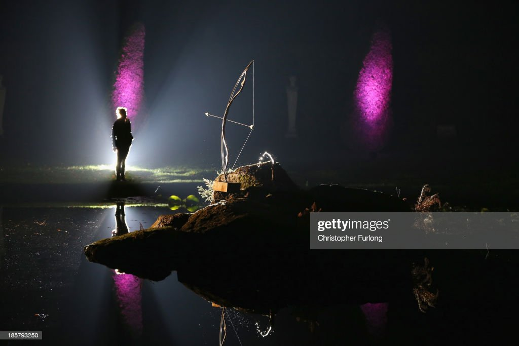 A member of staff views the illuminated Ring Pond in the gounds of Chatsworth stately home as it is lit up as part of the Luminaire event at Chatsworth House on October 24, 2013 in Chatsworth, England. The house and various features in the gardens are to be illuminated telling the story of the lunar cycle from October 26 to 30. The projections and light show are inspired by the famous painting of Duchess Georgiana as Diana, Goddess of the Moon. Luminaire will be the first time the house and garden has been displayed in this way for 170 years. It was last illuminated for the visit of Queen Victoria and Prince Albert in 1843.