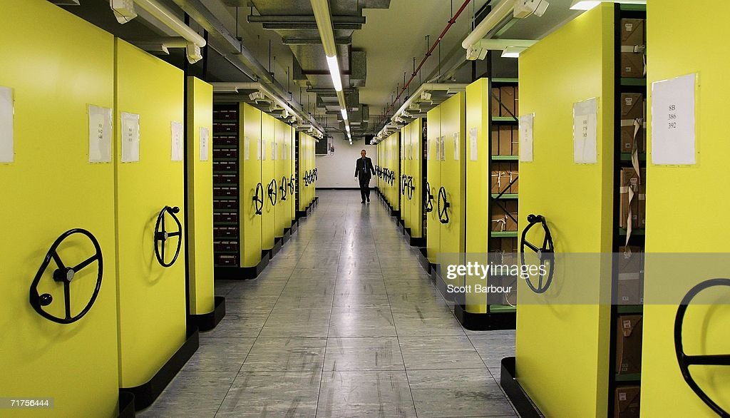 A member of staff walks through a depository at The National Archives on August 31, 2006 in London, England. The National Archives have announced the fifteenth release of Security Service records and the fourth since the full implementation of the Freedom of Information Act in January 2005. This release contains 214 files, bringing the total number of Security Service records in the public domain to well over 3,000.