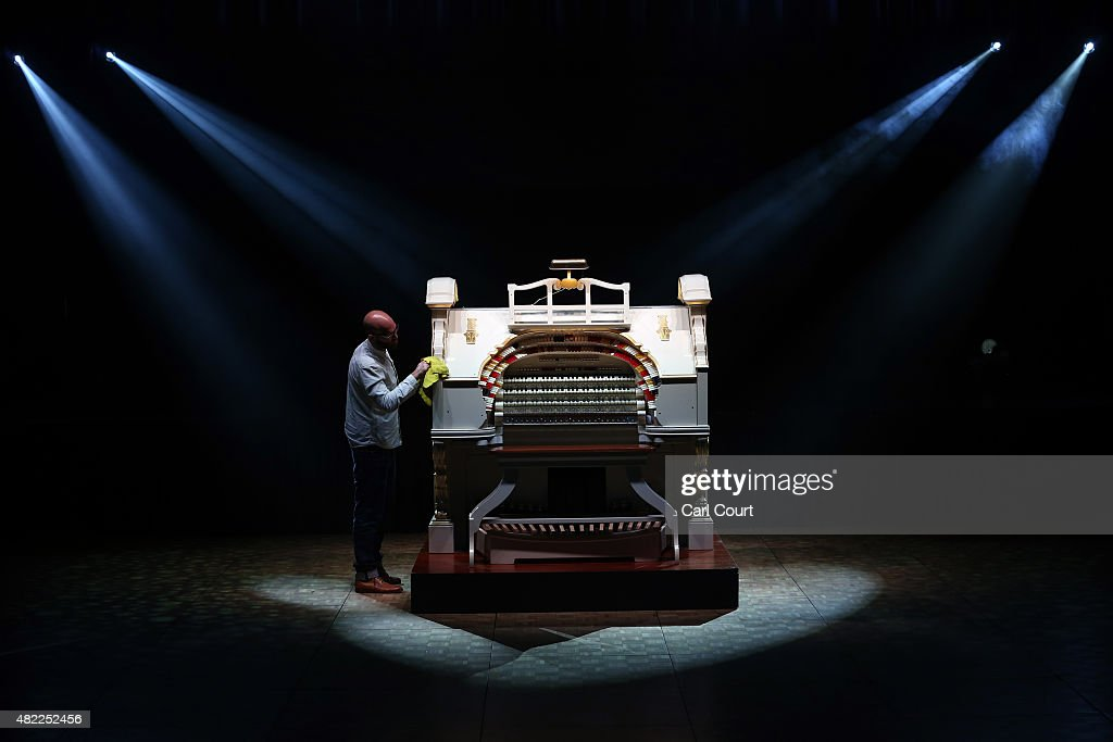 A member of staff wipes off Europe's largest Wurlitzer theatre pipe organ as it is unveiled after six years of restoration at the Troxy entertainment...