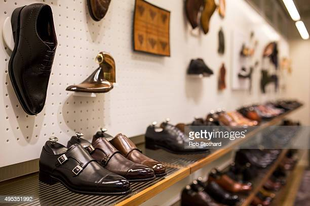 A member of staff works in the Joseph Cheaney and Sons Jermyn Street store on on September 1 2015 in London United Kingdom J Cheaney Boot Shoemakers...