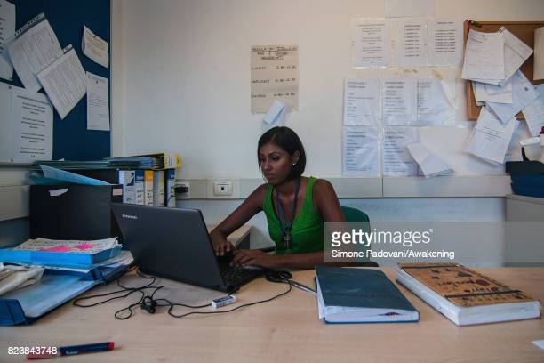 A member of staff works in the offices of Hub CARA Here they manage all the paths of the asylum seekers from their arrival in Italy until their...
