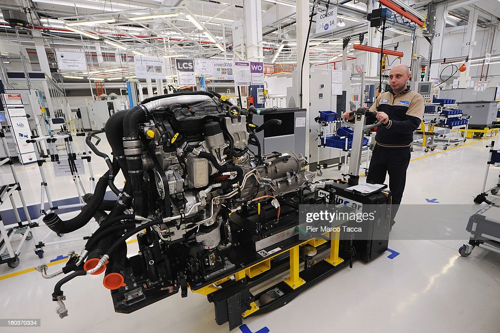 A member of staff works on the production line at the new Maserati plant during its unveiling in Grugliasco, which has been dedicated to Gianni Agnelli on January 30, 2013 in Turin, Italy. The new plant near the company's headquarters in Turin will produce Maserati's new model of luxury saloon cars, the Quattroporte.