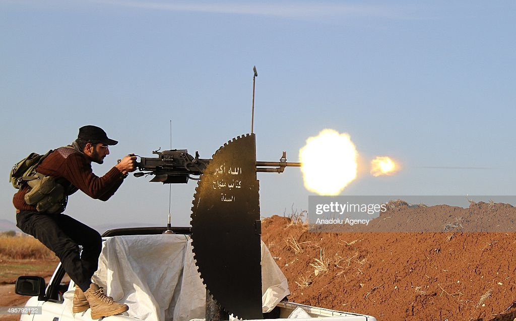 A Member of Syrian opposition group linked to Damascus Front (Shamiyya Front) fires a heavy-machine gun during clashes with Daesh militants in the Tel Malid village district of Mari in Aleppo, Syria on November 05, 2015.