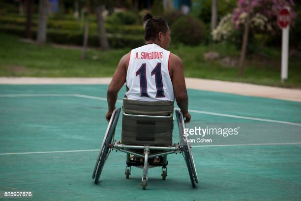 A member of Thailand's national wheelchair basketball team is portrayed here at a government sports facility in Cholburi province about an hour and a...