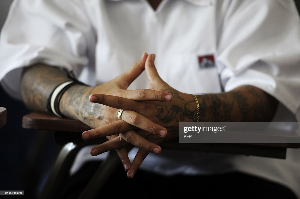 A member of the MS-13 gang participates in a press conference at the Sonsonate Central Jail in the city of Sonsonate, 65 Km west of San Salvador, on February 8, 2012. Leaders of the MS-13 and 18th Street gangs agreed to stop homicides in the city of Sonsonate, as part of the truce process between gangs to reduce crimes in El Salvador. AFP PHOTO/Jose CABEZAS