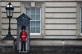 A member of the 1st Battalion Welsh Guards stands in a guards box as snow falls at Buckingham Palace in central London on March 23 2013 Today marks...