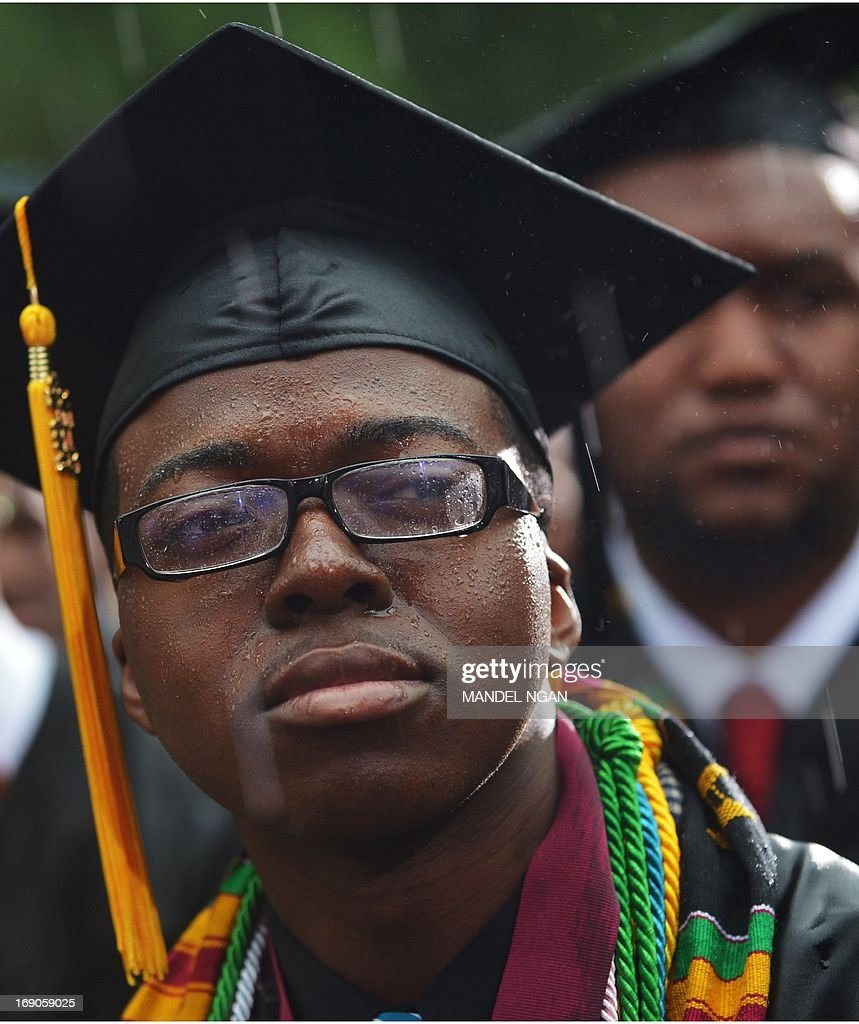 A member of the 2013 graduating class sits in the rain as he listens to US President Barack Obama deliver the commencement address during a ceremony at Morehouse College on May 19, 2013 in Atlanta, Georgia. AFP PHOTO/Mandel NGAN