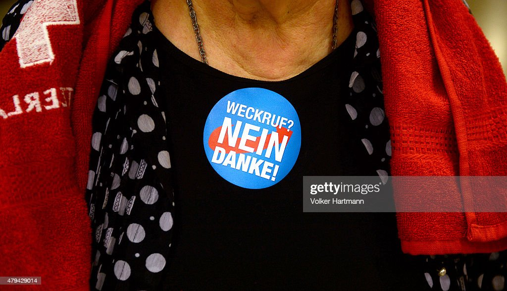A member of the AfD political party wears a sticker stating 'Weckruf Nein Danke' at the AfD federal party congress on July 4 2015 in Essen Germany...