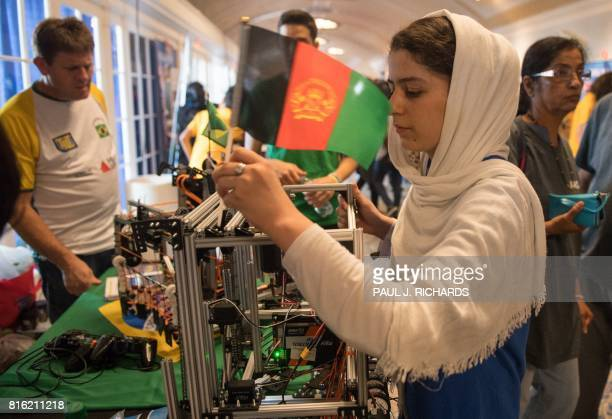 A member of the Afghan allgirls robotics team adjusts the flag on her robot July 17 between 2017 FIRST Global Challenge competitions at DAR...