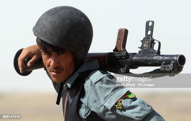 A member of the Afghan National Police holds a rocket propelled grenade launcher as he takes part in Operation Yaklang in Helmand Province Afghanistan
