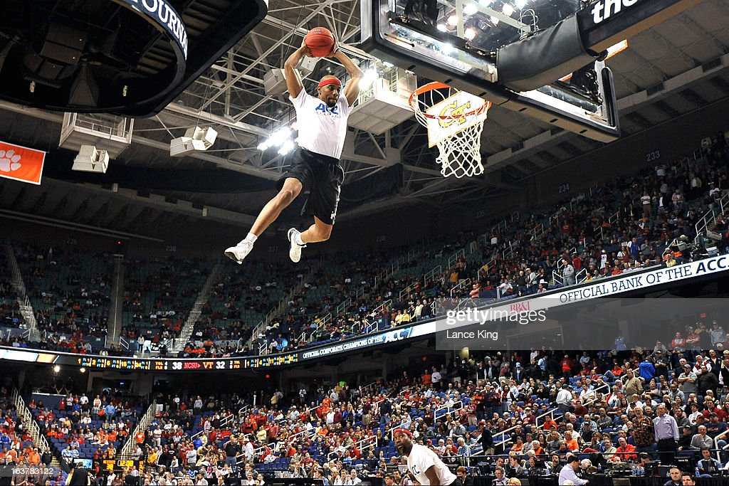 A member of the Air Elite Dunkers performs during halftime of a game between the Virginia Tech Hokies and the North Carolina State Wolfpack during the first round of the 2013 Men's ACC Tournament at the Greensboro Coliseum on March 14, 2013 in Greensboro, North Carolina. NC State defeated Virginia Tech 80-63.