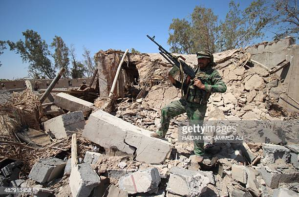 A member of the allied Iraqi forces consisting of the Iraqi army and fighters from the Popular Mobilisation units stands with his weapon on the front...