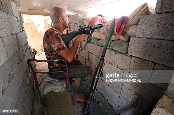 A member of the allied Iraqi forces consisting of the Iraqi army and fighters from the Popular Mobilisation units guards a look out point during...