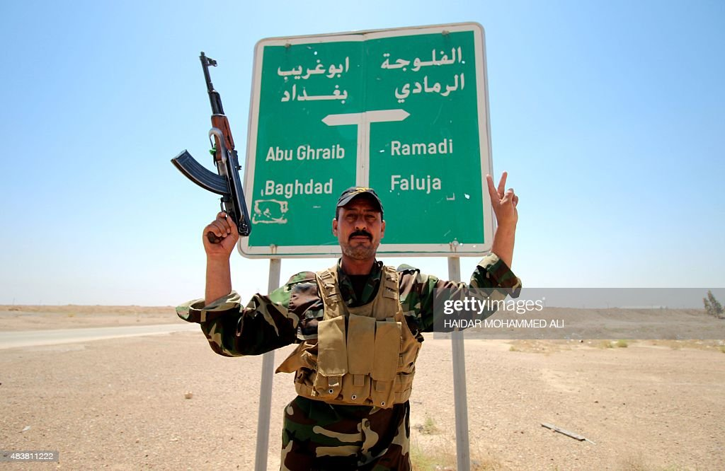 A member of the allied Iraqi forces consisting of the Iraqi army and fighters from the Popular Mobilisation units poses for a photo in front of a...