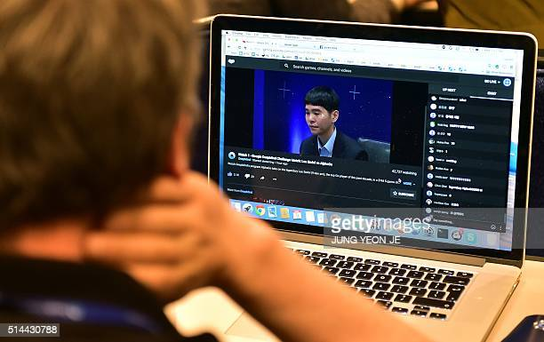 A member of the AlphaGo team watches an online live streaming of the Google DeepMind Challenge Match at a hotel in Seoul on March 9 2016 A...