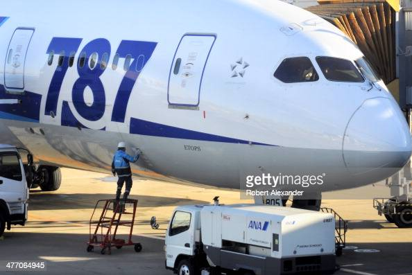 A member of the ANA ground crew services an ANA Boeing 787 Dreamliner at the gate at Narita International Airport near Tokyo Japan