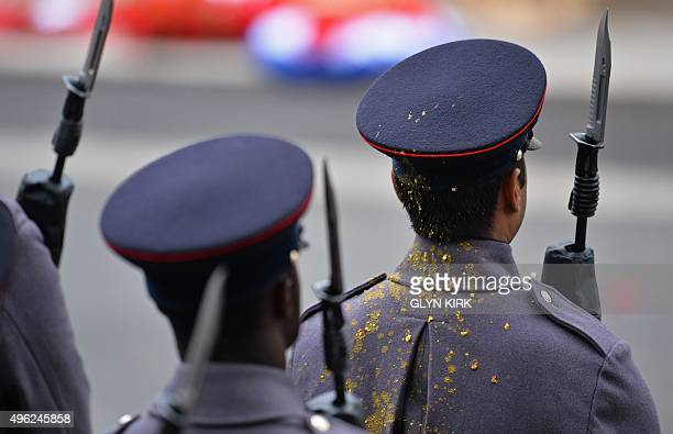 A member of the armed forces covered in bird excrement attends the Remembrance Sunday ceremony at the Cenotaph on Whitehall London on November 8 2015...