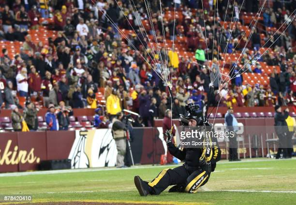 A member of the Army Golden Knights skydiving team lands in the end zone before a NFL game between the Washington Redskins and the New York Giants on...