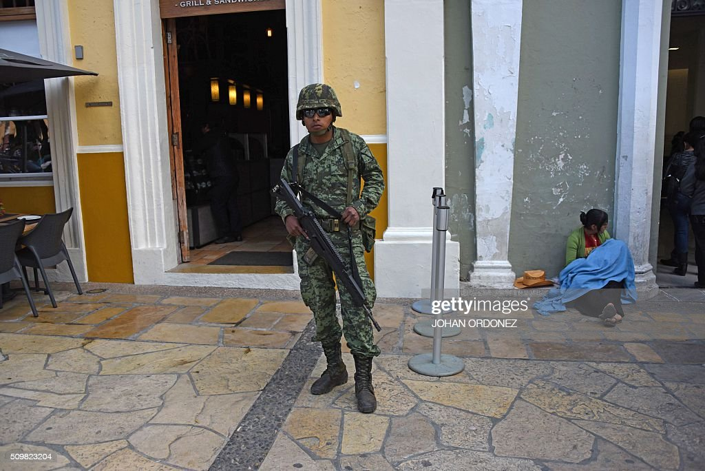 A member of the Army patrols the streets of San Cristobal de las Casas, Chiapas State, Mexico on February 12, 2016. Pope Francis will arrive in Mexico on Friday, where he will visit until February 17. AFP PHOTO/Johan ORDONEZ / AFP / JOHAN ORDONEZ