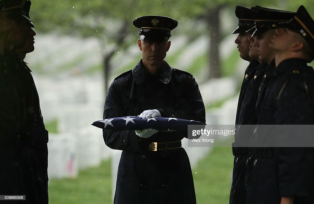 A member of the Army's 3rd Infantry Regiment 'The Old Guard' holds a flag during the funeral of Army Corporal David J. Wishon at Arlington National Cemetery May 6, 2016 in Arlington, Virginia. Corporal Wishon was assigned to a medical unit in the 7th Infantry Division when he went missing after an attack on Dec. 1, 1950 in the Korean War.