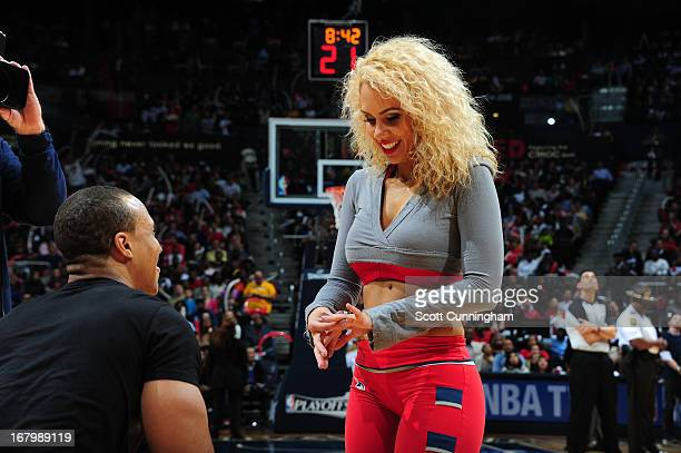A member of the Atlanta Hawks dance team has a wedding proposal during the halftime against the Indiana Pacers during Game Six of the Eastern...