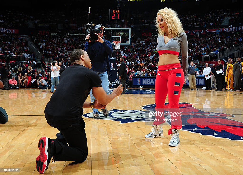 A member of the Atlanta Hawks dance team has a wedding proposal during the halftime against the Indiana Pacers during Game Six of the Eastern Conference Quarterfinals in the 2013 NBA Playoffs on May 3, 2013 at Philips Arena in Atlanta, Georgia.