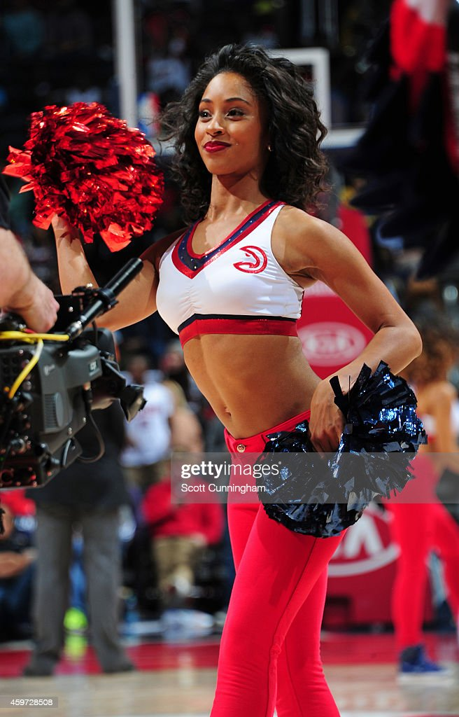 A member of the Atlanta Hawks Dance Team performs during the game against the Charlotte Hornets on November 29 2014 at Philips Arena in Atlanta...