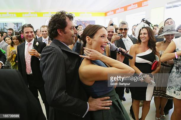 A member of the audience grabs hold of RickiLee Coulter as she sings in the Lavazza marquee on Crown Oaks Day at Flemington Racecourse on November 8...