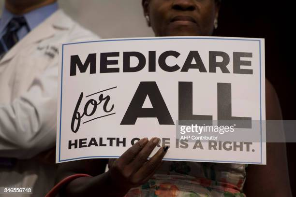 A member of the audience holds up a placard as US Senator Bernie Sanders Independent from Vermont discusses Medicare for All legislation on Capitol...