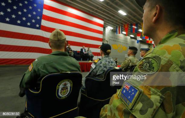 A member of the Australian Army sits in the audience alongside a US flag as the backdrop of a ceremony marking the start of Talisman Saber 2017 a...