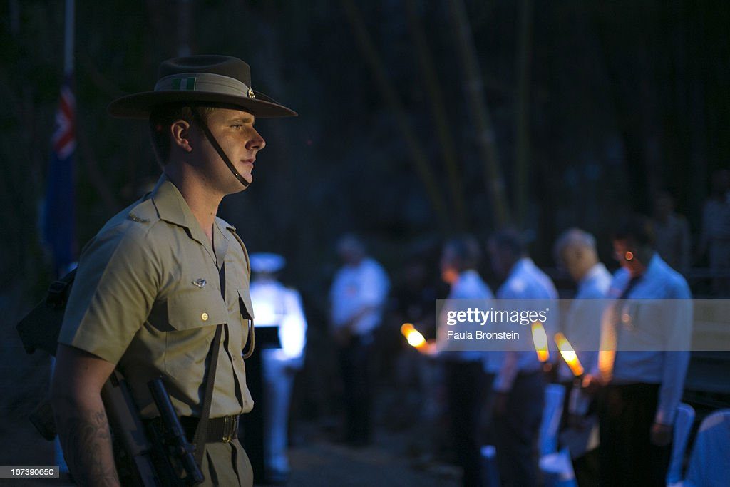 A member of the Australian honor guard stands at attention during a sunrise memorial service in remembrance of all those who lost their lives April 25, 2013 in Hellfire Pass, Thailand. Hellfire Pass is a small section of the Burma-Thailand railway which was built by POW's and Asian Laborers under horrific conditions during the Second World War (WWII). Heavy loss of life was suffered during construction due to disease, starvation and exhaustion.