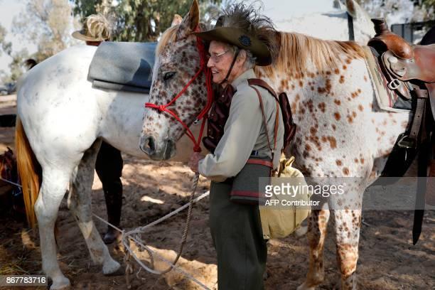 A member of the Australian Light Horse association prepares her horse on October 29 2017 near BeerSheva on the northern Israeli desert during a...