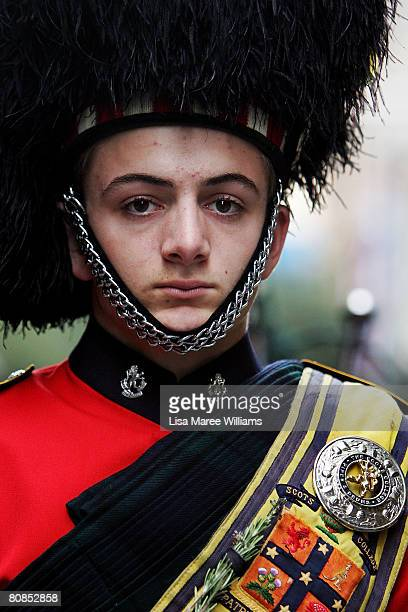 A member of the Australian Scots College Pipes Drums band marches along George Street during Anzac Day Commemorations on April 25 2008 in Sydney...