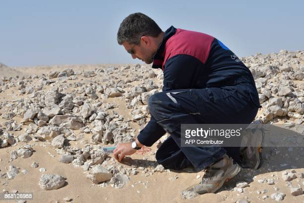 A member of the Austrian Space Forum inspects a site in Oman's Dhofar desert near the southern Marmul outpost on October 29 in preparation for a...