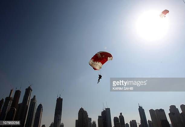 A member of the Bahraini team is pictured above Dubai's skyscrapers during the Gulf emirate's 2nd International Parachuting Championship and Gulf Cup...