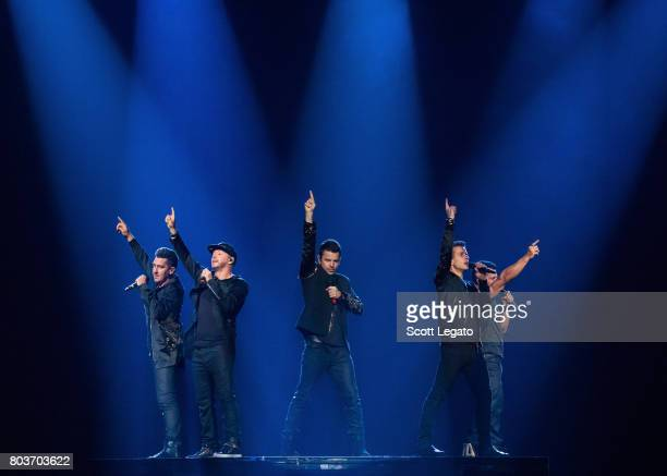 Member of the band NKOTB Jonathan Knight Jordan Knight Joey McIntyre Donnie Wahlberg and Danny Wood perform during The Total Package Tour at The...