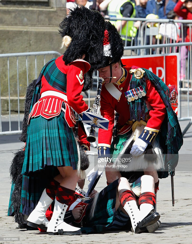 A member of the Band of the Royal Regiment of Scotland collapses during the Thistle Service at St Giles' Cathedral on July 7, 2016 in Edinburgh, Scotland. The Most Ancient and Most Noble Order of the Thistle is an order of chivalry associated with Scotland.