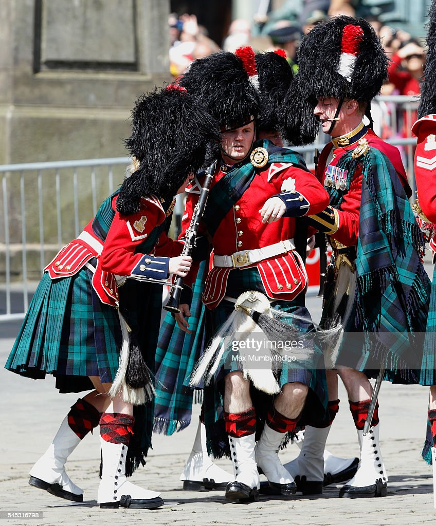 A member of the Band of the Royal Regiment of Scotland is helped to his feet after collapsing during the Thistle Service at St Giles' Cathedral on July 7, 2016 in Edinburgh, Scotland. The Most Ancient and Most Noble Order of the Thistle is an order of chivalry associated with Scotland.