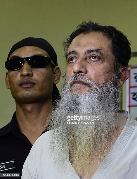 A member of the Bangladeshi Rapid Action Battalion accompanies suspect and Bangladeshorigin British citizenTouhidur Rahman who has been arrested with...