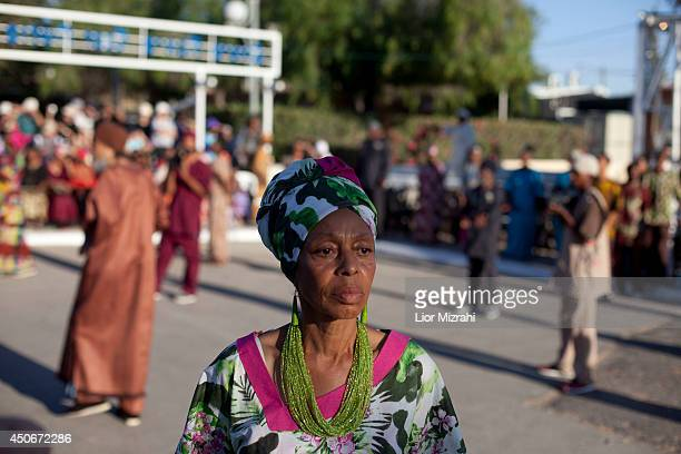 A member of the Black Hebrews community is seen during the celebration of Shavuot harvest festival on June 15 2014 in Dimona Israel The community who...